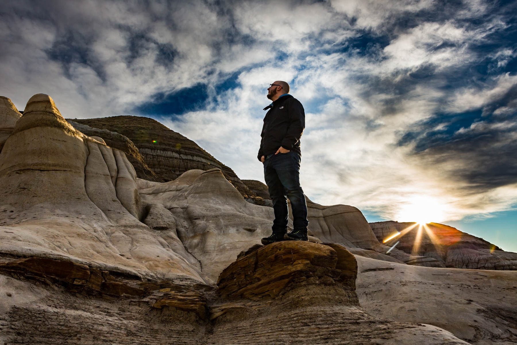 Man standing on Hoodoos - Drumheller, Alberta  - Tracey Sawatzky, Adventure Photographer