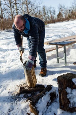 man cutting wood