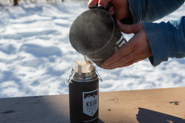 pouring water into kuju coffee pouch