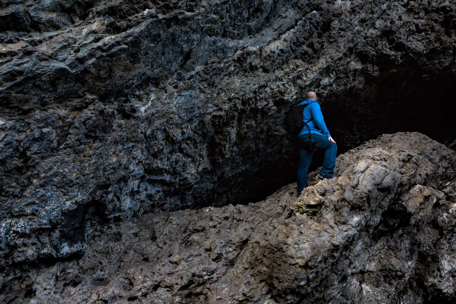 Man exploring rock/cave formation at Grassi Lakes - Canmore, Alberta  - Tracey Sawatzky, Adventure Photographer