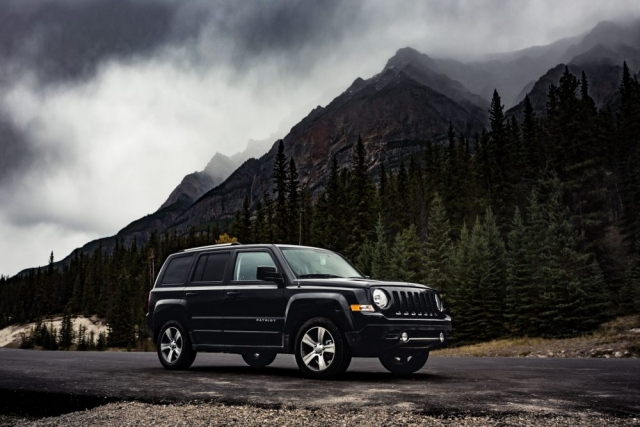 Parked Black Jeep Patriot on the Icefields Parkway - Jasper, Alberta  - Tracey Sawatzky, Adventure Photographer