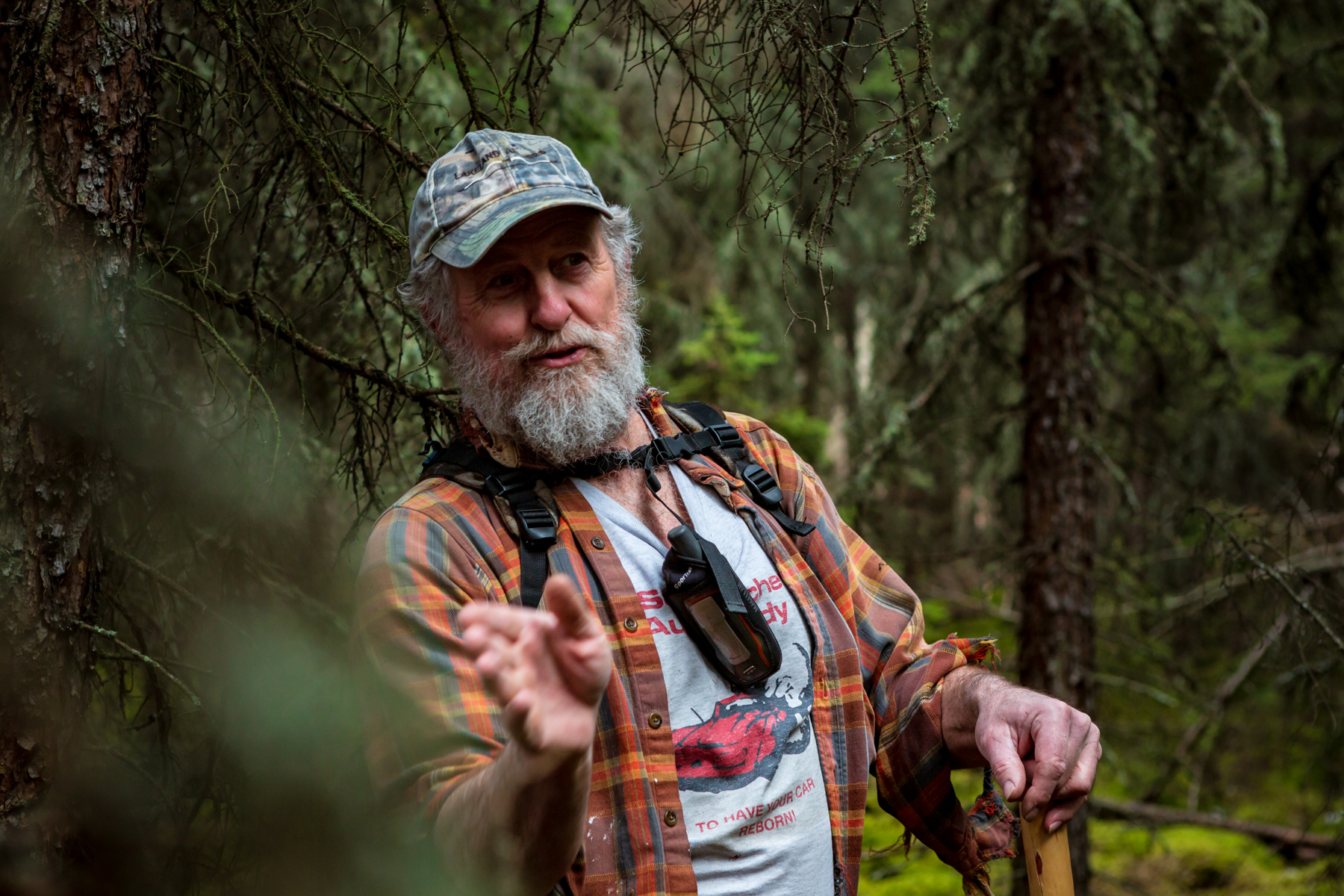 man standing in forest telling stories